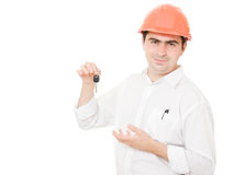 Businessman with a key in the helmet. Stock Image