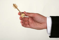Businessman with a key in his hand Royalty Free Stock Images
