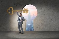 The businessman with key and jigsaw puzzle pieces Stock Image