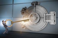 The businessman with key near bank vault door. Businessman with key near bank vault door Stock Photo