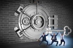 The businessman with key near bank vault door. Businessman with key near bank vault door Stock Images