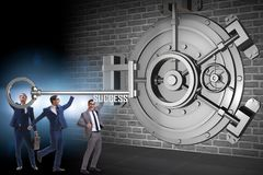 The businessman with key near bank vault door. Businessman with key near bank vault door Royalty Free Stock Images