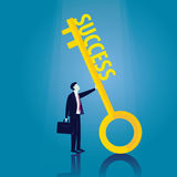 Businessman with Key of Success Stock Image