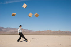 Businessman kicking boxes Stock Photography
