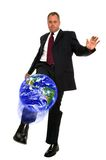 Businessman kicking globe Stock Images