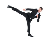 Businessman kicking over white background Stock Photo