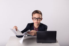 Businessman kid holding blanks in his hands. Businessman kid in business suit holding blanks in his hands Stock Photography