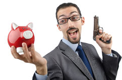 Businessman killing piggy bank Royalty Free Stock Photos