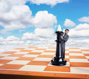 Businessman and king on the chess board Royalty Free Stock Images