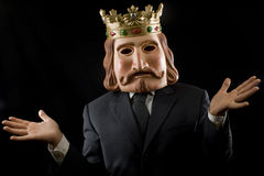 Businessman with king mask surprised. Isolated on black stock image