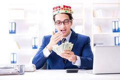 The businessman king with money in the office. Businessman king with money in the office Stock Photography
