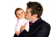 Businessman kissing baby Royalty Free Stock Photos