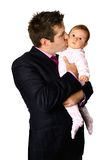 Businessman kissing his baby Royalty Free Stock Image