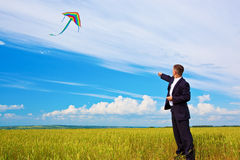 Businessman and kite Royalty Free Stock Images