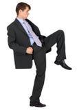 Businessman knee kick on white background Royalty Free Stock Photo