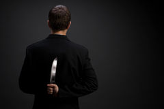Businessman with knife Stock Photography
