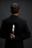 Businessman with knife Royalty Free Stock Photo