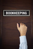 Businessman knocking on Bookkeeping office door Stock Images