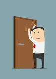 Businessman knocking on a closed door Royalty Free Stock Images