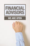 Businessman knocking on Financial Advisors office door. Looking for a help or advice Royalty Free Stock Photography