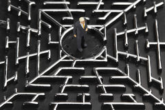 Businessman in a labyrinth Royalty Free Stock Images