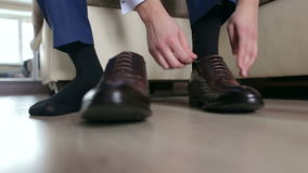Businessman lace up black shoes, close-up. stock video footage