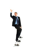 Businessman on a ladder. In white background Royalty Free Stock Image