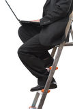 Businessman on ladder Royalty Free Stock Photos