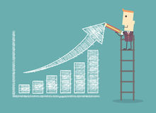 Businessman on a ladder charting a positive trend graph Royalty Free Stock Photography
