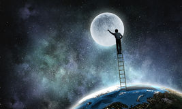 Businessman on ladder. Businessman climbing up the staircase as success achievement concept. Elements of this image are furnished by NASA Stock Image