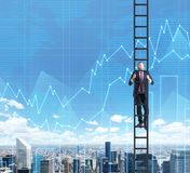 A businessman in a ladder is climbing up to the success in his career in finance. Flowcharts are over New York city view Stock Photo