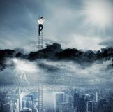 Businessman on a ladder escapes from crisis and looking for a new way Royalty Free Stock Photos