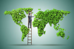 The businessman on ladder in green environment concept. Businessman on ladder in green environment concept Stock Image