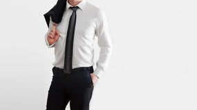 Businessman in laid-back, relaxed pose on white background. Royalty Free Stock Photo