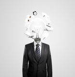 Businessman with lamp head Stock Images