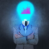 Businessman with lamp-head. As business success concept stock photos