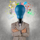 Businessman with lamp-head as business success. As concept design royalty free stock photo