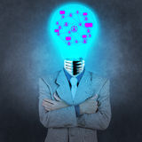 Businessman with lamp-head as social network concept. Design stock photo