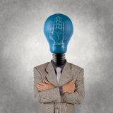 Businessman with lamp-head and hand rised sign royalty free stock photos