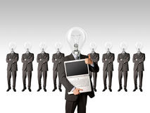 Businessman with lamp-head have got an idea. Male businessman with lamp-head and laptop have got an idea Stock Image