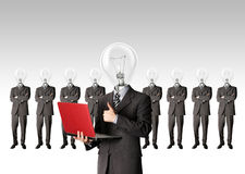 Businessman with lamp-head have got an idea. Male businessman with lamp-head and laptop have got an idea Royalty Free Stock Photos
