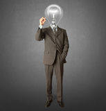 Businessman with lamp-head and marker. Writting something on glass writeboard Royalty Free Stock Photo