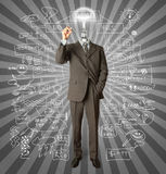 Businessman with lamp-head and marker. Writting something on glass writeboard Stock Images