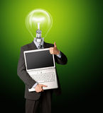 Businessman with lamp-head with open laptop. Shows welldone Royalty Free Stock Images