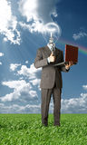 Businessman with lamp-head outdoors. Full length businessman with laptop and lamp-head outdoors Stock Photography
