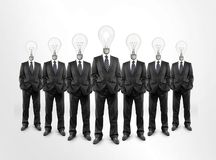 Businessman  lamp in heads Royalty Free Stock Images