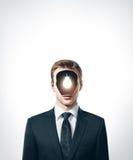 Businessman with lamp inside head Stock Photos