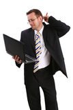 Businessman with lap top. Over white royalty free stock image
