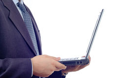 Businessman with a laptop Royalty Free Stock Image