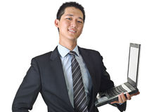 Businessman with laptop. Happy business man holding laptop against white stock images